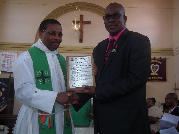 NMB Executive Mayor, Cllr Zanoxolo Wayile, presented St Stephen's Anglican Church with a plaque of honour for their contribution toward the community. Accepting the award on behalf of the church is resident pastor, Rev. Zwelidumile Tom.