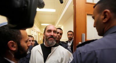 """Yaakov """"Jack"""" Teitel, a U.S. immigrant to a settlement in the occupied West Bank, arrives for a sentencing hearing at the Jerusalem District Court April 9, 2013. The West Bank settler dubbed """"The Jewish Terrorist"""" by the Israeli media was sentenced on Tuesday to life imprisonment for the attempted murder of Messianic Pastors David and Leah Ortiz in 2008, among other crimes. (Baz Ratner/Reuters)"""