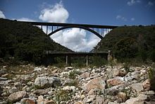 A view of the N2 Van Stadens bridge from the bottom of the gorge.The old R102 bridge is visible in the foreground.