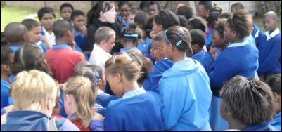 Prayer action on a school field.