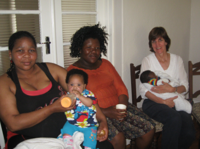 Moms with their babies at a monthly  'Sinesipho' Mom's group meeting, with Alternatives trustee and volunteer, Nicky Moore (right).