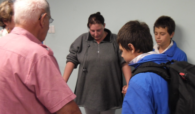A mom of twins at the school is healed of a hernia during prayer.