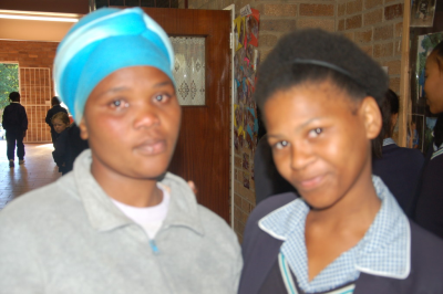 A community service worker (left) at Alexandira ChIstian Academy (ACA) was led to accept Jesus Christ as her Saviour by a learner (right) from  Fountain Of Life Christian School, Uitenhage. A team from the Uitenhage school which is experiencing revival visited ACA on Friday (June 14) to 'spread the revival fire'.