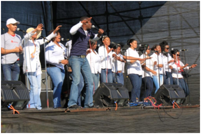 A combined worship team, made up of members from each church's worship teams, at the Eldos Stadium prayer rally.