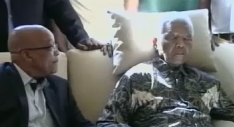President Jacob Zuma at the hospital bedside of ailing former Presdent Nelson Mandela. (PHOTO: TV screenshot)