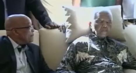 President Jacob Zuma at the hospital bedside of ailing former Presdent Nelson Mandela. (PHOTO: TV screenshot)