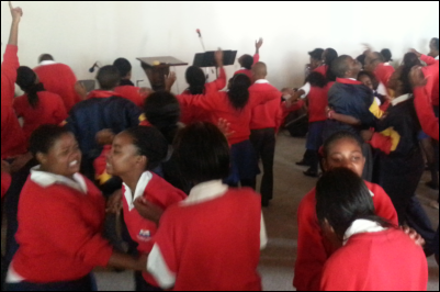 Learners worshiping God and ministering to one another.