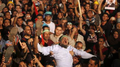 Muslim Brotherhood members and pro-Morsi supporters react in Cairo.