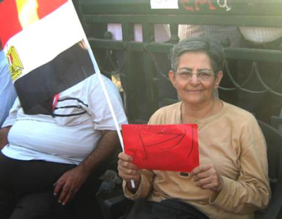 "Hebatalla Safwat Ghali in Tahrir Square. ""As a Coptic I present my Christian love of my country. I care about my people's worries."" (PHOTO: World Watch Monitor)."
