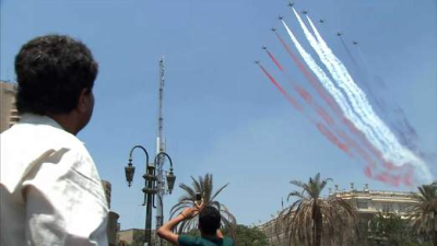 A military flypast in Cairo as the Interim President is sworn in.