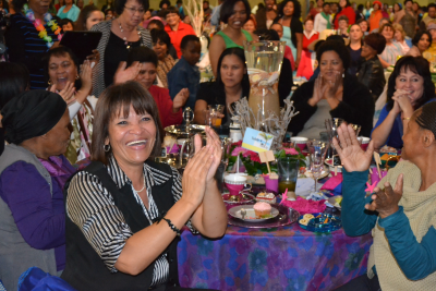 Women in enjoying the annual High Tea at Victory Ministries International.
