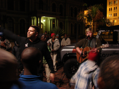 Luke Watson (left) and Mark Kock (on guitar) lead worship at a 'city feed'.