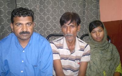 Rights activist Basharat Khokhar, left; Mizrak Masih, centre; daughter Rimsha, right, in early 2013, after her release. World Watch Monitor