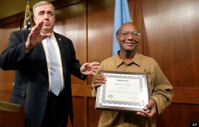 Boston Police Commissioner Edward Davis (left) honours homeless here GlenJames with a special citation.