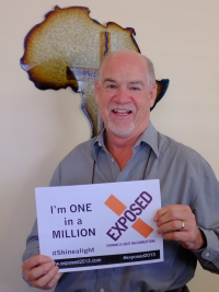 Graham Power, Chairman of the Power Group and founder of Unashamedly holding a sign referring to the million signatories campaign.,