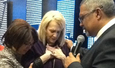 Pastor Jerome Liberty of Victory Ministries Intenrational, PE and his wife, Pastor Eunice, pray with visiting US preacher, Pastor Sheryl Brady.