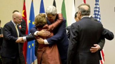 US Secretary of State John Kerry, center, embraces EU foreign policy chief Catherine Ashton, during a ceremony at the United Nations after an agreement was reached on Iran's nuclear program, in Geneva, Switzerland, Sunday, Nov. 24, 2013. (PHOTO: AP Photo/Keystone, Martial Trezzini/Times of Israel)