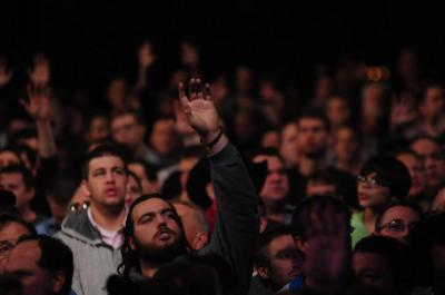 Men worshiping God at the Mighty Men USA on Sunday.