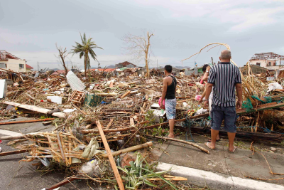 Trashed cities and villages testify to the power of the typhoon and sea surge that struck the Philippines.