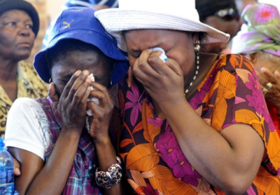 Community members held a prayer service at the Assemblies of God Church in Kimberley following the rape of a 6-week-old baby in Galeshewe and the rape and murder of an 87-year-old woman from the same community. The service was held on Wednesday (November 28 2013). Above: Family members sob bitterly. Pictures: Emile Hendricks/Foto24.