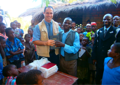 Michael hands over Chichewa Bibles to Christians in Malawi.