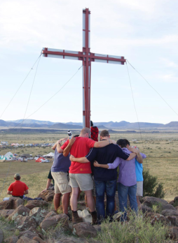 Men at the cross which overlooks the KMMC campsite at KMMC 2014.