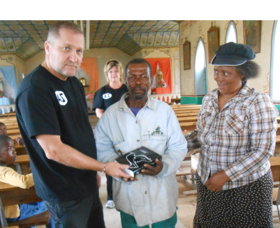 Pastor Siphiwe and his wife at the church at Sani Top – 27 December 2013 – he handed his last bible out and prayed for bibles for weeks, we passed his church on our way to St James and stop to see what we can offer them on our next visit, we gave 5 bibles to him.