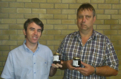 Christian Friendly Products founders Etienne de Jager (left) and Bertus Griebnow, with food products bearing the new label.