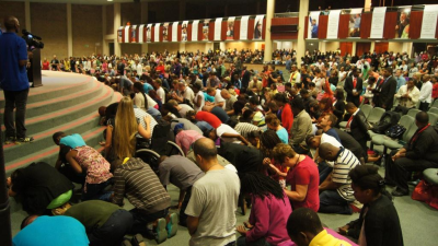 Souls kneel at the altar, giving their all to Jesus at the Fire2014 Conference in Johannesburg last weekend.