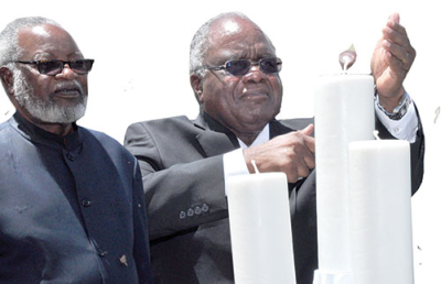 At 13h00, Pohamba accompanied by the Founding Father Dr Sam Nujoma and other leaders lit candles and the nation observed a moment of silence.