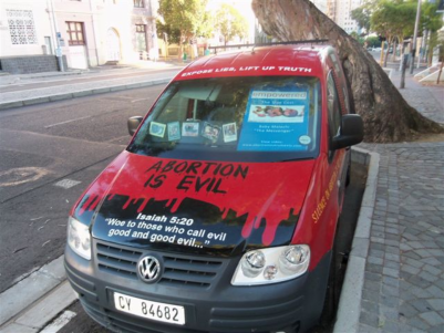 "He also sent this photo of his 'pro-life mobile' parked outside the clinic. His photo caption:""My response to their advertising!"""