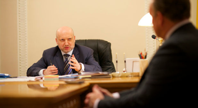 Viktor Hamm (right), the Billy Graham Evangelistic Association's vice president of crusades, meets with Ukraine's acting president, Oleksandr Turchynov, on Wednesday. (BGEA)