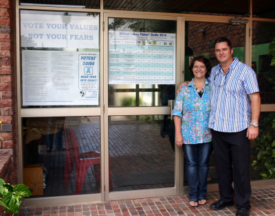 Pastor Stef Davi and his wife Julia at the entrance to the church.