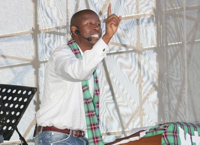 Afrika Mhlophe speaking at KMMC 2013. He is one of the speakers at KMMC 2014.
