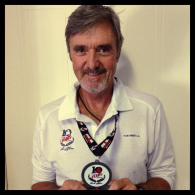 Richard sporting his Iron Man medal at the office on the Monday morning after the event.