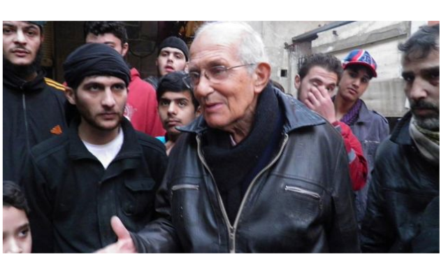 Dutch Jesuit Fr Frans van der Lugt chats with civilians in the besieged area of Homs on January 29th. Fr van der Lug was shot dead by unidentified gunmen in Homs. (PHOTO: Yazan Homsy/Reuters)