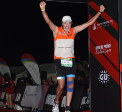 Elated and thankful to God, Richard crosses the Iron Man 2014 finish line at 11pm after gutting it out since early morning.
