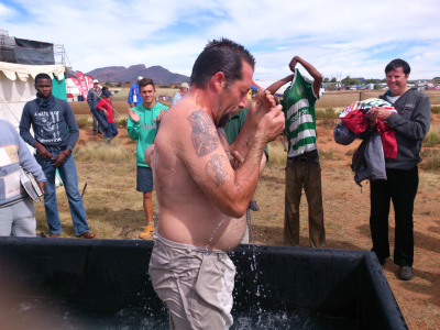 Johan Muller of Bloemfontein was one of many men who were baptised in a special bath outside the prayer tent.