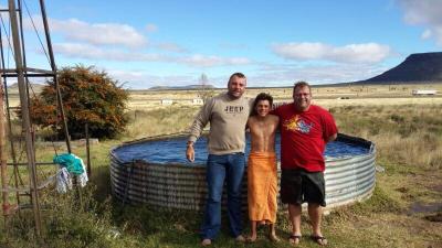 Pictured after their baptism in a farm dam near Colesberg, (from left) Anton van der Walt, Micheal van der Walt and Marinus Ferreira.