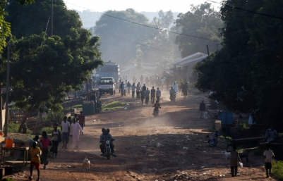 (Photo: Reuters/GORAN TOMASEVIC) People walk along a main street in the Central African Republic capital of Bangui where at least 30 people were killed in an attack by Muslim extremists on a Christian church at a refugee camp on May 28, 2014.