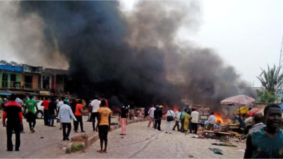 Smoke rises after a bomb blast at a bus terminal in Jos, Nigeria. Two explosions ripped through a bustling bus terminal and market frequented by thousands of people in Nigeria's central city of Jos on Tuesday afternoon. (AP Photo/Stefanos Foundation),