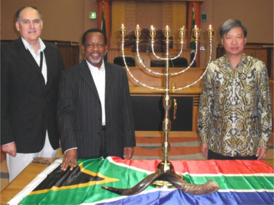 The first stop in the Menorah Mission at the church of Rev Kenneth Meshoe (centre) in Gauteng
