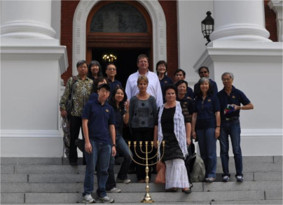 The mission group in front of Parliament in Cape Town, with a menorah they released there.