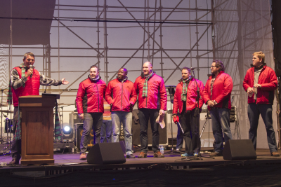 Jannie Moolman (event coordinator of the KMMC 2014) introduces the speakers and worship leaders, (from left) Leon Schoeman, Afrika Mhlophe, Johnny Louw, Dewald Gouws, Joe Niemand and Retief Burger.