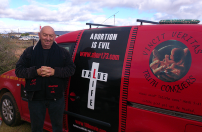 Prolife activist Peter Throp with his 'pro-life-mobile' which he drove from Cape Town to the KMMC 2014 near Middelburg.