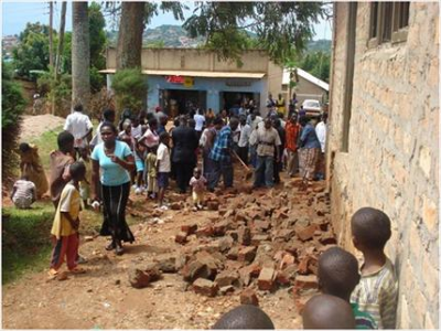 The members of World Possessor's Church International, in Namasuba, Uganda, examine the rubble left after an extremist Islamist attack during their worship service. November 2009 (PHOTO: World Watch Monitor)