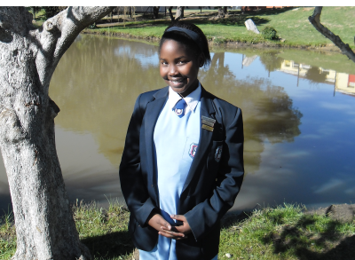 Siphosethu Bahyi at the dam at Walmer West Primary School, Port Elizabeth where, in a vision, she saw 'men' with bodies of molten lava.