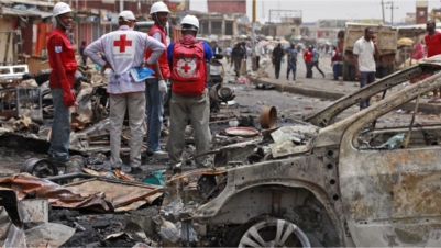 May 21, 2014: In this file photo, Red Cross personnel search for remains at the site of one of a car bomb in Jos, Nigeria. Boko Haram militants are taking over villages in northeastern Nigeria, killing and terrorizing civilians and political leaders, witnesses say, as the Islamic fighters make a comeback from a year-long military offensive aimed at crushing them.AP/Sunday Alamba/File
