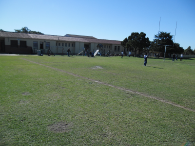 The sports field and school building that were covered in fire in Siphoyethu's vision.