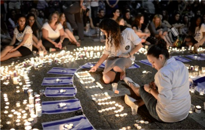 Israelis light candles in Tel Aviv's Rabin Square on Monday as they mourn the news of the death of three abducted Jewish teenagers. Israeli forces found the bodies of the three missing teenagers on Monday after a nearly three-week-long search. (Tomer Neuberg/Flash90) - See more at: http://www.gospelherald.com/articles/51813/20140703/israel-vows-that-hamas-terrorist-group-will-pay-for-abducting-killing-teens.htm#sthash.x4MAw8G7.dpuf